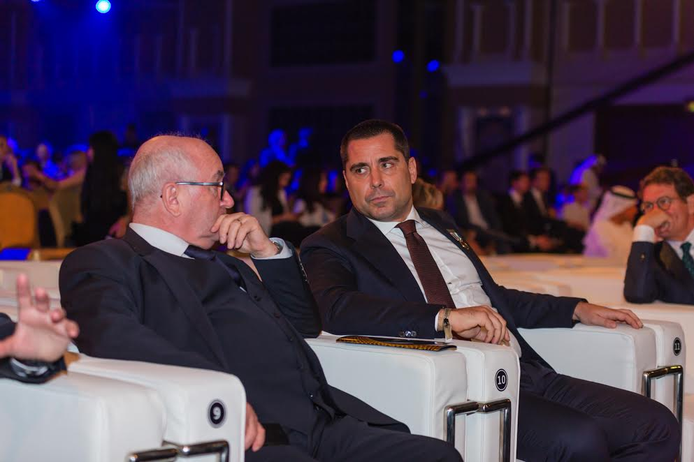 Riccardo Silva is talking with Carlo Tavecchio, sit down on white chairs, in Dubai, December 2016